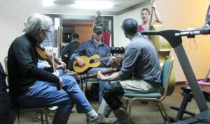 George, Caleb, Ron and Emily jamming in the exercise room
